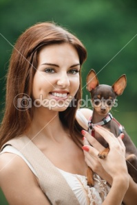 dep_6279608-Portrait-of-young-smiling-woman-holding-dog